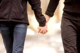 couple holding hands - couples sex coaching